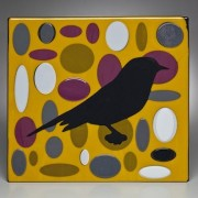 BLACK BIRD IN YELLOW FIELD