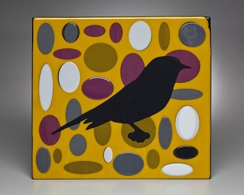 BLACK BIRD IN YELLOW FIELD