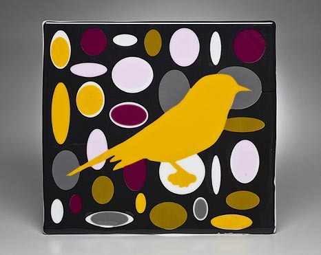 YELLOW BIRD IN BLACK FIELD