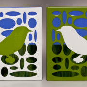 GREEN AND WHITE BIRDS IN ELLIPSE/SKY GROUND LANDSCAPE